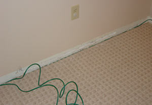 Running 3 lines under the baseboard